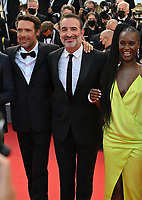 CANNES, FRANCE. July 17, 2021: Nicolas Bedos, Jean Dujardin & Fatou N'Diaye at the Closing Gala & Awards Ceremony, and From Africa With Love Premiere at the 74th Festival de Cannes.<br /> Picture: Paul Smith / Featureflash