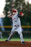 Travis Dean #34 of the Spokane Indians pitches against the Hillsboro Hops at Hillsboro Ballpark on July 22, 2013 in Hillsboro Oregon. Spokane defeated Hillsboro, 11-3. (Larry Goren/Four Seam Images)