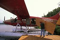 Hauling building supplies on a De Havilland Otter bush plane, Talkeetna, Alaska