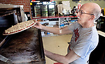 WOLCOTT, CT. - 12 May 2021-051221SV07-Bill Accousti, owner, makes a cheese pizza at Five Guys Flippin Pies in Wolcott Wednesday. The state is set to vote on making pizza the state food.<br /> Steven Valenti Republican-American