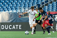 FOXBOROUGH, MA - JULY 9: Damian Rivera #72 of New England Revolution II dribbles as Antonio Carlini #85 of Toronto FC II defends during a game between Toronto FC II and New England Revolution II at Gillette Stadium on July 9, 2021 in Foxborough, Massachusetts.