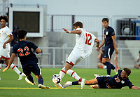 WASHINGTON, DC - SEPTEMBER 6: Maryland defender Brett St. Martin (12) moves between Virginia midfielder Michael Tsicoulias (22) and forward Daniel Wright (23) during a game between University of Virginia and University of Maryland at Audi Field on September 6, 2021 in Washington, DC.