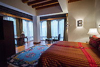 Bhutan, Paro, rooms at Zhiwa Ling Hotel.