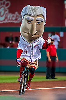 7 October 2017: Washington Nationals Presidential Mascot George Washington rides a bicycle in the Presidents Race between innings of the second NLDS game against the Chicago Cubs at Nationals Park in Washington, DC. The Nationals defeated the Cubs 6-3 and even their best of five Postseason series at one game apiece. Mandatory Credit: Ed Wolfstein Photo *** RAW (NEF) Image File Available ***