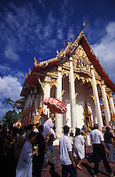 Religious figure is carried around a Buddhist temple in Phuket, Thailand