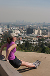 People working out at Runyon Canyon Park with a view over Hollywood and Downtown Los Angeles, CA