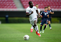 ZAPOPAN, MEXICO - MARCH 21: Benji Michel #14 of the United States chases down a loose ball during a game between Dominican Republic and USMNT U-23 at Estadio Akron on March 21, 2021 in Zapopan, Mexico.