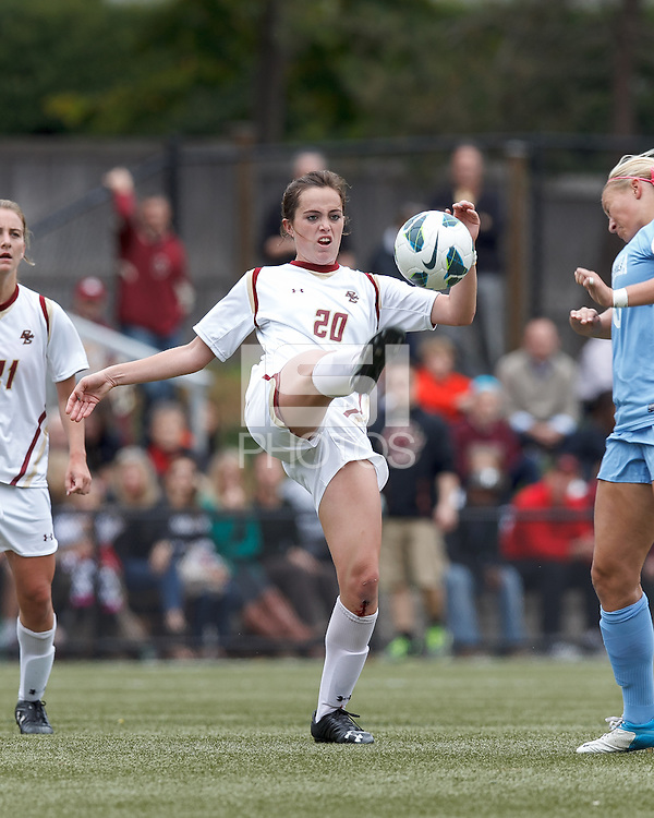 Boston College defender Zoe Lombard (20) clears the ball.   University of North Carolina (blue) defeated Boston College (white), 1-0, at Newton Campus Field, on October 13, 2013.