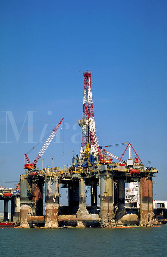 Offshore drilling platforms being serviced, overhauled, Galveston ship channel. Galveston Texas.
