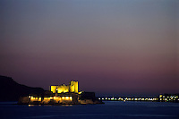 Illuminated island with Château d'If surrounded by the sea, Marseille, France.