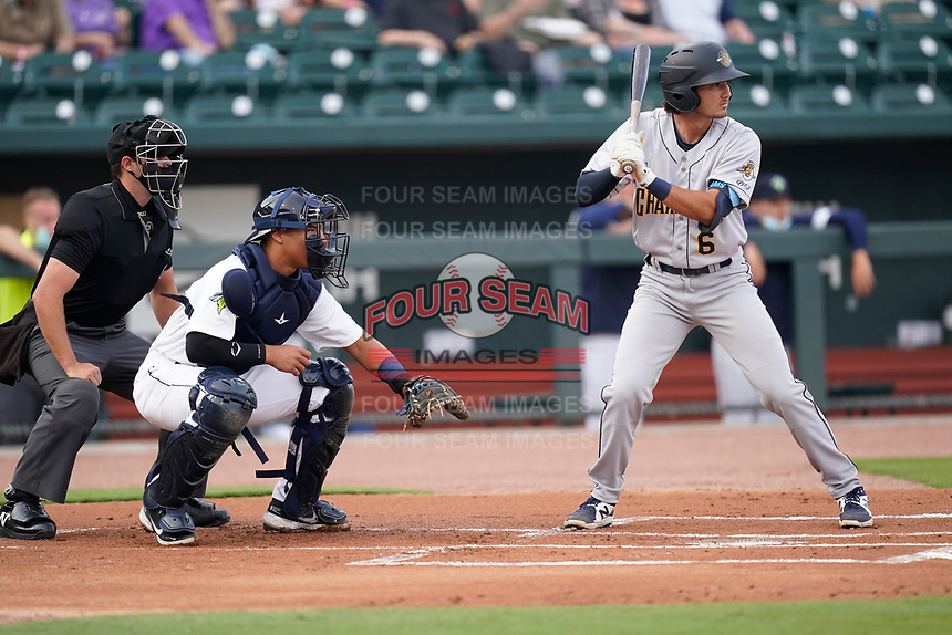 Shortstop Alika Williams (6) of the Charleston RiverDogs in a game against the Columbia Fireflies on Tuesday, May 11, 2021, at Segra Park in Columbia, South Carolina. The catcher is Omar Hernandez (6) and the umpire is Paul Roemer. (Tom Priddy/Four Seam Images)