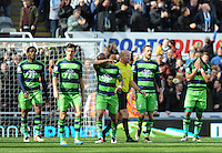 Swansea City players are dejected after conceding a goal during the Barclays Premier League match between Newcastle United and Swansea City played at St. James' Park, Newcastle upon Tyne, on the 16th April 2016
