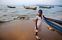 TANZANIA Musoma, Lake Victoria, girl at fishing boat / Tansania Region Mara, Musoma, Maedchen am Viktoria See