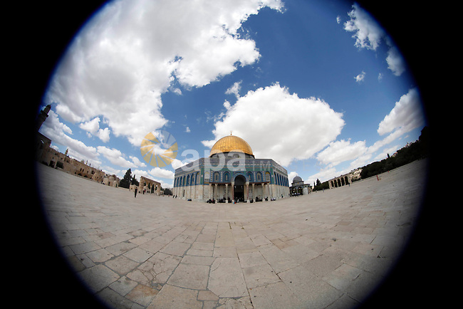 Palestinian worshipers pray outside the Dome of the Rock mosque at the Al-Aqsa compound, Islam s third holiest site, in the old city of Jerusalem, on October 4, 2013. Photo by Saeed Qaq