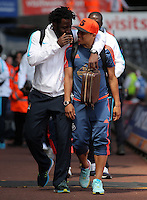 ( L-R ) Wilfried Bony of Manchester City and Jefferson Montero of Swansea City share jokes as they arrive during the Swansea City FC v Manchester City Premier League game at the Liberty Stadium, Swansea, Wales, UK, Sunday 15 May 2016