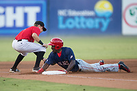 Daniel Johnson (7) of the Hagerstown Suns slides head first into third base after hitting a triple against the Kannapolis Intimidators at Kannapolis Intimidators Stadium on June 15, 2017 in Kannapolis, North Carolina.  The Intimidators defeated the Suns 9-1 in game two of a double-header.  (Brian Westerholt/Four Seam Images)
