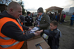 Runcorn Town 1 Runcorn Linnets 0, 26/12/2013. The Pavilions, North West Counties League Premier Division. A home supporter buying a programme inside the ground before the Boxing Day derby match between Runcorn Town and visitors Runcorn Linnets at the Pavilions, Runcorn, in a top-of the table North West Counties League premier division match. Runcorn Linnets won 1-0 and overtook their neighbours at the top of the league in a game watched by 803 spectators. Runcorn Linnets were a successor club to Runcorn FC, one of England foremost non-League clubs of the 1970s and 1980s. Photo by Colin McPherson.