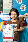 Education Elementary school Grade 2 girl holding up self portrait of self as president vertical art activity social studies