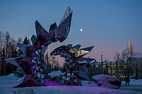 "A half moon sets over the Heath Satow sculpture ""Inflorescence"" in front of UAA's ConocoPhillips Integrated Science Building."