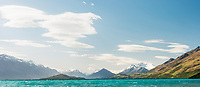 Lenticular clouds over windy Lake Wakatipu with Southern Alps in background, Central Otago, New Zealand, NZ