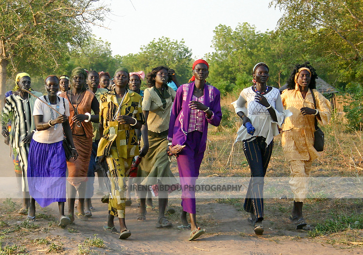 Women march and sing in a wedding procession in Rumbek, South Sudan.
