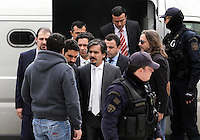 Pictured: The eight Turkish men are being escorted by police officers to the Supreme Court in Athens, Greece. Thursday 26 January 2017<br /> Re: Greece's Supreme Court has ruled against extraditing eight Turkish soldiers whom the Turkish government accuses of being involved in last July's attempted coup.<br /> The eight men fled in a helicopter to Greece after the coup attempt but say they were not involved.<br /> Turkey has demanded they return to stand trial. The soldiers say their lives would be in danger.<br /> The case has presented a diplomatic dilemma for Greece.<br /> Senior prosecutors had argued against agreeing to extradition. The court's decision is final and cannot be appealed against.