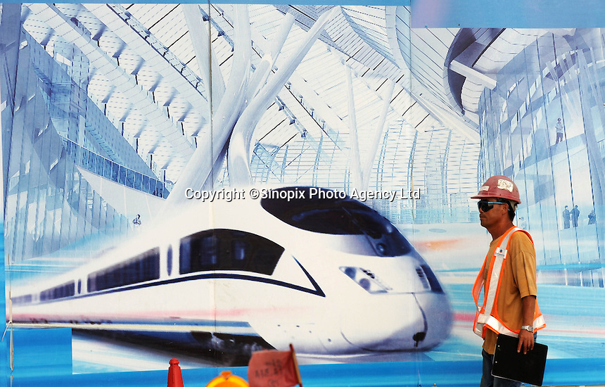 A sign for the new Hong Kong-Guangzhou, Express-Link will carry passengers between Hong Kong and China. China is expanding all high-speed rail links..17 May 2011