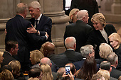 Former Vice President Al Gore, left, greets former President Bill Clinton, second from left, as his wife, former Secretary of State Hillary Clinton, right, greets former Vice President Joe Biden, bottom center, before a State Funeral for former President George H.W. Bush at the National Cathedral, Wednesday, Dec. 5, 2018, in Washington. Also pictured is former President Jimmy Carter, second from right. <br /> Credit: Andrew Harnik / Pool via CNP