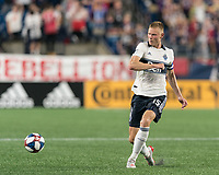 FOXBOROUGH, MA - JULY 18: Andy Rose #15 passes the ball during a game between Vancouver Whitecaps and New England Revolution at Gillette Stadium on July 18, 2019 in Foxborough, Massachusetts.