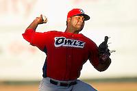 Orem Owlz starting pitcher Jairo Diaz (44) in action against the Ogden Raptors at Lindquist Field on July 27, 2012 in Ogden, Utah.  The Raptors defeated the Owlz 6-3.   (Brian Westerholt/Four Seam Images)