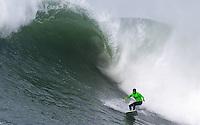 Half Moon Bay, California - January 24, 2014: 2014 Maverick's Invitational Ryan Augenstein starightening out.