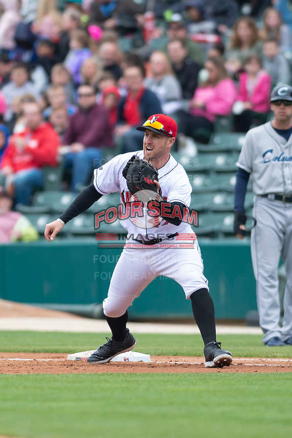 Indianapolis Indians first baseman Patrick Kivlehan (47) prepares to catch a throw ahead of Eric Stamets (7) during an International League game against the Columbus Clippers on April 30, 2019 at Victory Field in Indianapolis, Indiana. Columbus defeated Indianapolis 7-6. (Zachary Lucy/Four Seam Images)