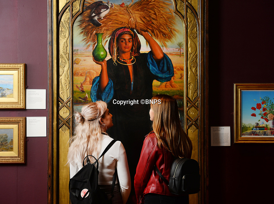 BNPS.co.uk (01202 558833)<br /> Pic: ZacharyCulpin/BNPS<br /> <br /> Pictured: Gallery visitors take a close look at William Holman Hunt's 1854 painting Afterglow in Egypt. <br /> <br /> A Pre-Raphaelite exhibition opens today at the Russell Coates Gallery in Bournemouth. <br /> <br /> Beyond the Brotherhood: The Pre-Raphaelite Legacy exhibition highlights its beginings, the importance of the Pre-Raphaelite movement all the way to the high fantasty art of the Lord of the Rings and Game of Thrones. <br /> <br /> In partnership with Southampton City Art Gallery and featuring loans from the Victoria and Albert Museum, the Royal Academy, Tate Britan the exhibition and runs until 21st June