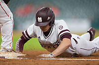 Hunter Vansau (32) of the Mississippi State Bulldogs dives back towards first base during the game against the Houston Cougars in game six of the 2018 Shriners Hospitals for Children College Classic at Minute Maid Park on March 3, 2018 in Houston, Texas. The Bulldogs defeated the Cougars 3-2 in 12 innings. (Brian Westerholt/Four Seam Images)