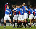 Rangers v Celtic 5.2.02: Bert Konterman mobbed after his goal and Barry ferguson goes tonto