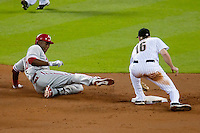 Philadelphia Phillies outfielder John Mayberry Jr #15 slides into second base during the Major League Baseball game against the Houston Astros at Minute Maid Park in Houston, Texas on September 13, 2011. Houston defeated Philadelphia 5-2.  (Andrew Woolley/Four Seam Images)