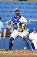 Dunedin Blue Jays catcher Derrick Chung (1) checks the runner during a game against the Daytona Cubs on April 14, 2014 at Florida Auto Exchange Stadium in Dunedin, Florida.  Dunedin defeated Daytona 1-0  (Mike Janes/Four Seam Images)