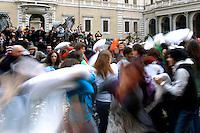 Battaglia dei cuscini in piazza Santa Maria in Trastevere, Roma, 15 aprile 2012..People take part in a pillow fight event in Rome, 15 april 2012..UPDATE IMAGES PRESS/Riccardo De Luca