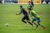 SAN JOSE, CA - OCTOBER 18: Shea Salinas #6 of the San Jose Earthquakes escapes Alex Roldan #16 of the Seattle Sounders during a game between Seattle Sounders FC and San Jose Earthquakes at Earthquakes Stadium on October 18, 2020 in San Jose, California.