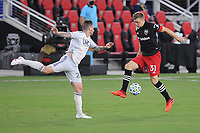 WASHINGTON, DC - AUGUST 25: Julian Gressel #31 of D.C. United battles for the ball with Alexander Buttner #28 of New England Revolution during a game between New England Revolution and D.C. United at Audi Field on August 25, 2020 in Washington, DC.