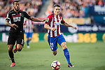 Kevin Gameiro of Atletico de Madrid fights for the ball with Ruben Miguel Nunes Vezo of Granada CF during their La Liga match between Atletico de Madrid and Granada CF at the Vicente Calderon Stadium on 15 October 2016 in Madrid, Spain. Photo by Diego Gonzalez Souto / Power Sport Images