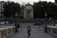 """Piazza Trilussa (Trastevere).<br /> <br /> Rome, 12/03/2020. Documenting Rome under the Italian Government lockdown for the Outbreak of the Coronavirus (SARS-CoV-2 - COVID-19) in Italy. On the evening of the 11 March 2020, the Italian Prime Minister, Giuseppe Conte, signed the March 11th Decree Law """"Step 4 Consolidation of 1 single Protection Zone for the entire national territory"""" (1.). The further urgent measures were taken """"in order to counter and contain the spread of the COVID-19 virus"""" on the same day when the WHO (World Health Organization, OMS in Italian) declared the coronavirus COVID-19 as a pandemic (2.).<br /> ISTAT (Italian Institute of Statistics) estimates that in Italy there are 50,724 homeless people. In Rome, around 20,000 people in fragile condition have asked for support. Moreover, there are 40,000 people who live in a state of housing emergency in Rome's municipality.<br /> March 11th Decree Law (1.): «[…] Retail commercial activities are suspended, with the exception of the food and basic necessities activities […] Newsagents, tobacconists, pharmacies and parapharmacies remain open. In any case, the interpersonal safety distance of one meter must be guaranteed. The activities of catering services (including bars, pubs, restaurants, ice cream shops, patisseries) are suspended […] Banking, financial and insurance services as well as the agricultural, livestock and agri-food processing sector, including the supply chains that supply goods and services, are guaranteed, […] The President of the Region can arrange the programming of the service provided by local public transport companies […]».<br /> Updates: on the 12.03.20 (6:00PM) in Italy there 14.955 positive cases; 1,439 patients have recovered; 1,266 died.<br /> <br /> Footnotes & Links:<br /> Info about COVID-19 in Italy: http://bit.do/fzRVu (ITA) - http://bit.do/fzRV5 (ENG)<br /> 1. March 11th Decree Law http://bit.do/fzREX (ITA) - http://bit.do/fzRFz (ENG)<br /> 2. http://bit.do/fzRKm"""