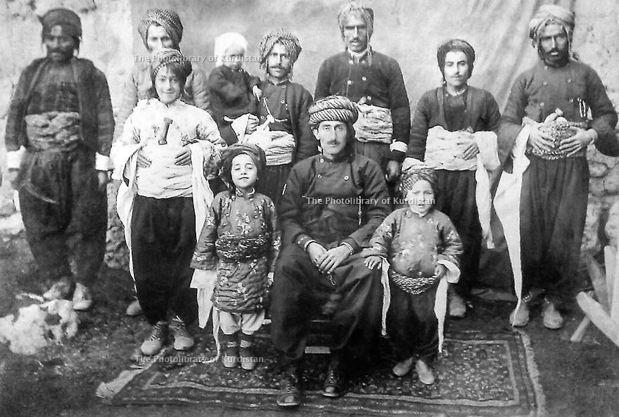 Iran 1930  Village of  Trkashe, sitting in the middle, Fereidun Beg Amiri, nickname: Haji Shahab with his children, standing next to him from left to right; Hama  Khan Amiri, Ahmed Khan Amiri, Habib Khan Amiri and Abdulla Khan Amii in the arm of an adult     Iran 1930  Dans le village de Trkashe, un chef de tribu, assis, avec ses enfants et ses proches, Fereidun Beg Amiri dit Haji Shahab, debout a coté de lui , de gauche a droite: Hama Khan Amiri, Ahmed Khan Amiri, Habib Khan Amiri et Abdulla Khan Amiri dans les bras d'un adulte
