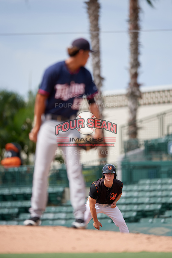 GCL Orioles third baseman Jared Gates (18) leads off first base during the first game of a doubleheader against the GCL Twins on August 1, 2018 at CenturyLink Sports Complex Fields in Fort Myers, Florida.  GCL Twins defeated GCL Orioles 7-6 in the completion of a suspended game originally started on July 31st, 2018.  (Mike Janes/Four Seam Images)