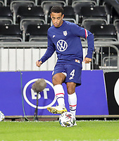 SWANSEA, WALES - NOVEMBER 12: Tyler Adams #4 of the United States national team warming up before a game between Wales and USMNT at Liberty Stadium on November 12, 2020 in Swansea, Wales.