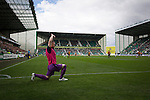 Hibernian 3 Alloa Athletic 0, 12/09/2015. Easter Road stadium, Scottish Championship. One of the visiting substitutes going through a stretching routine at Easter Road stadium during the first-half of the Scottish Championship match between Hibernian and visitors Alloa Athletic. The home team won the game by 3-0, watched by a crowd of 7,774. It was the Edinburgh club's second season in the second tier of Scottish football following their relegation from the Premiership in 2013-14. Photo by Colin McPherson.