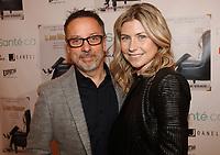 Serge Beauchemin (G) et Eliane gamache, la jeune milionnaire lors de son lancement de livre en novembre 2014.<br /> <br /> <br /> PHOTO : Agence Quebec Presse