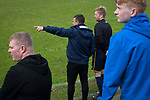 Home manager Carl Jarrett pointing something to his coach during the first-half at Mount Pleasant as Marske United (in yellow) take on Billingham Synthonia in a Northern League division one fixture. Formed in 1956 in Marske-by-the-Sea, the home club had secured automatic promotion to the Northern Premier League two days before and were in the midst of a run of six home games in 10 days as they attempted to overtake Morpeth Town to win the league. They won this match 6-1 against already relegated Billingham, watched by a crowd of 196.