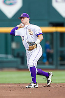 LSU Tigers second baseman Jared Foster (17) makes a throw to first base against the TCU Horned Frogs in the NCAA College World Series on June 14, 2015 at TD Ameritrade Park in Omaha, Nebraska. TCU defeated LSU 10-3. (Andrew Woolley/Four Seam Images)