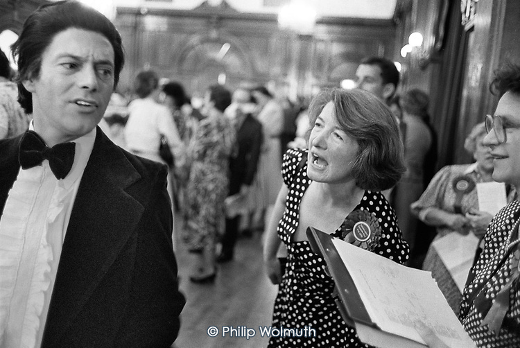 Katie Ivens, Conservative, newly elected to Westminster City Council, exchanges insults with  stand-up comedian Keith Allen at the 1990 local election count, Porchester Hall. The Conservatives, later found guilty of gerrymandering, increased their majority from 4 to 38 seats.
